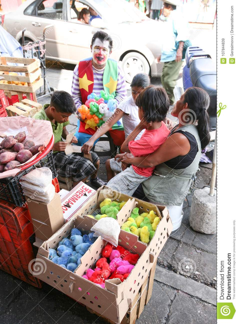 Traders selling little painted chicks on a local market in Oaxaca, Mexico