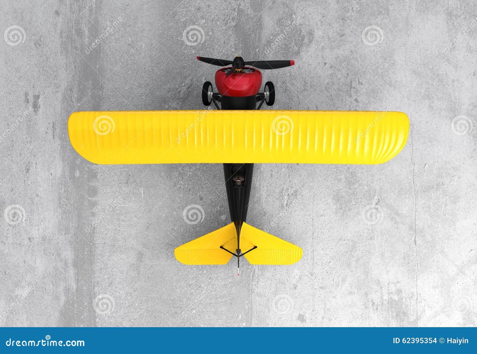 Oberseitenansicht eines gelben und schwarzen Doppeldeckers auf dem Boden