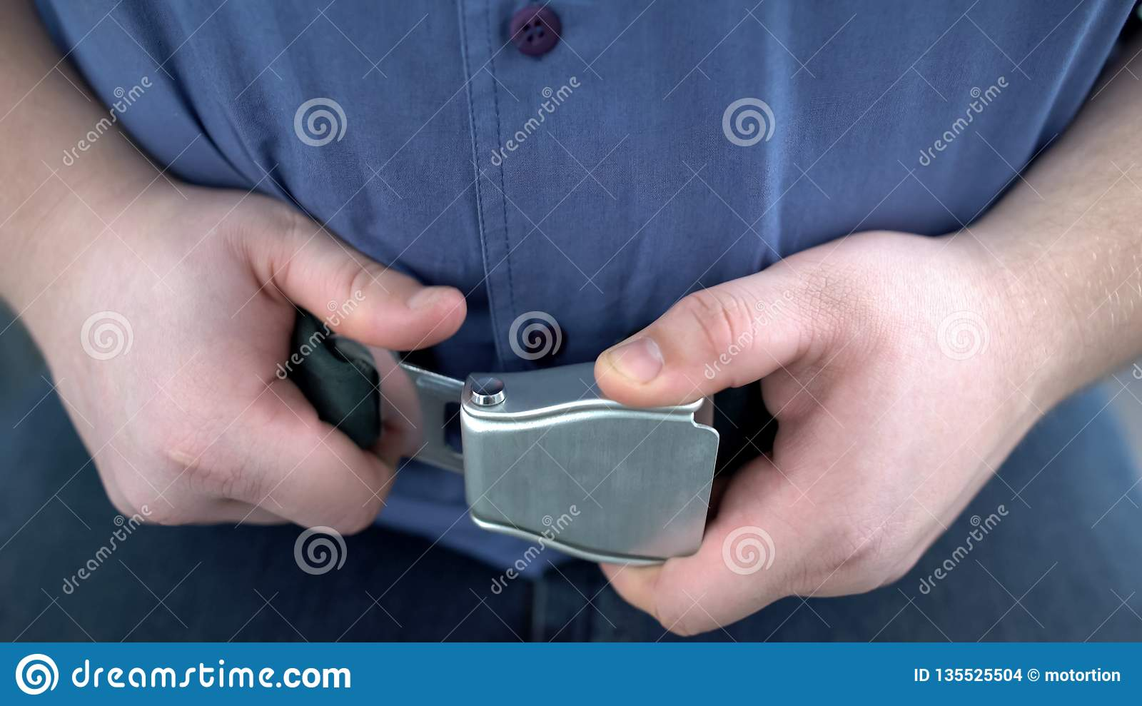 Obese male passenger fastening seat belt while sitting on airplane, safe flight