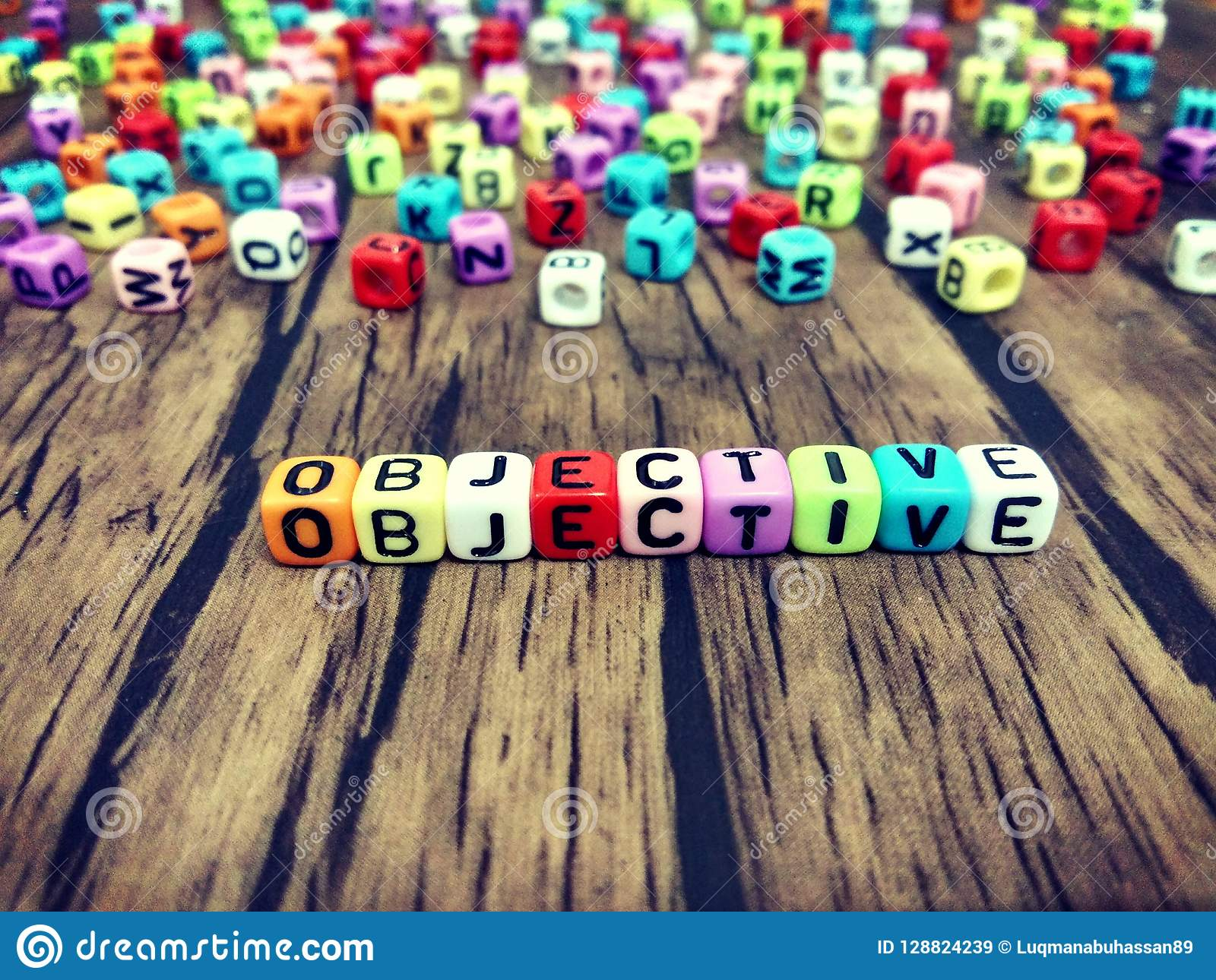 OBJECTIVE word of colourful cube alphabets.