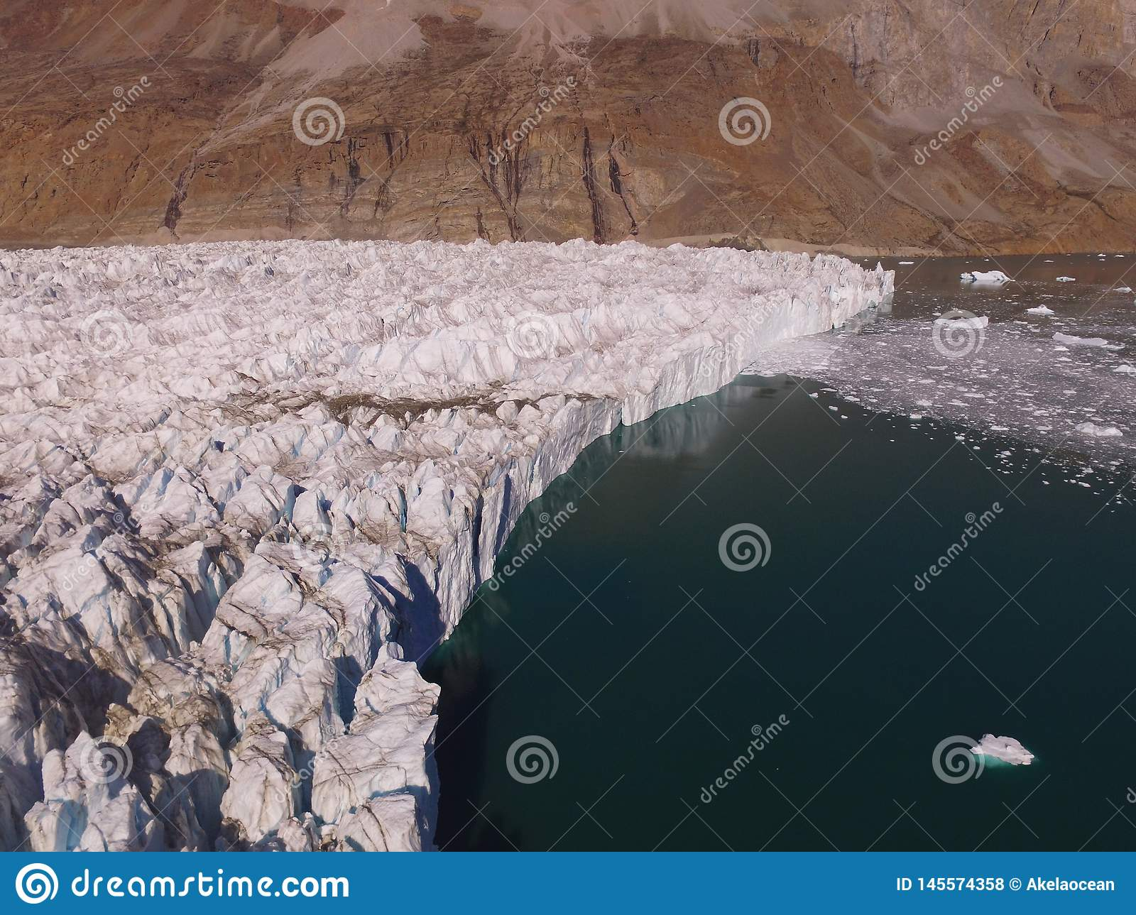 Oblique drone aerial image of the terminus of a glacier in a fjord in northeast Greenland