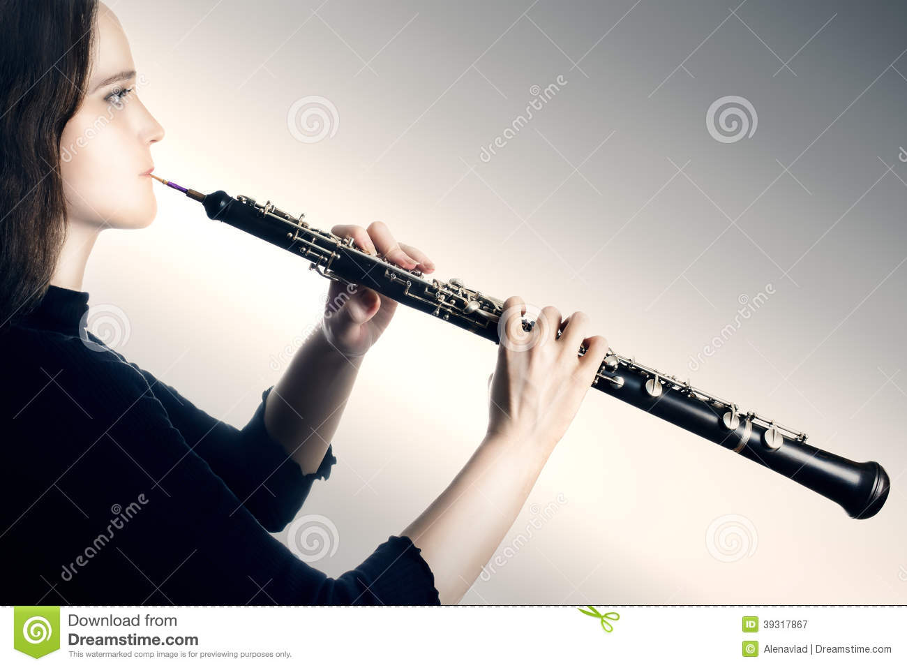 Oboe classical orchestra musician. Oboist music instrument playing.