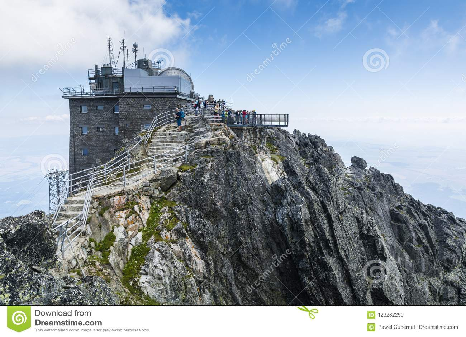 Observatory at Lomnica peak Observatorium na Lomnickom stite, Observatorium Lomnicky stit and tourists walking on viewing platfo