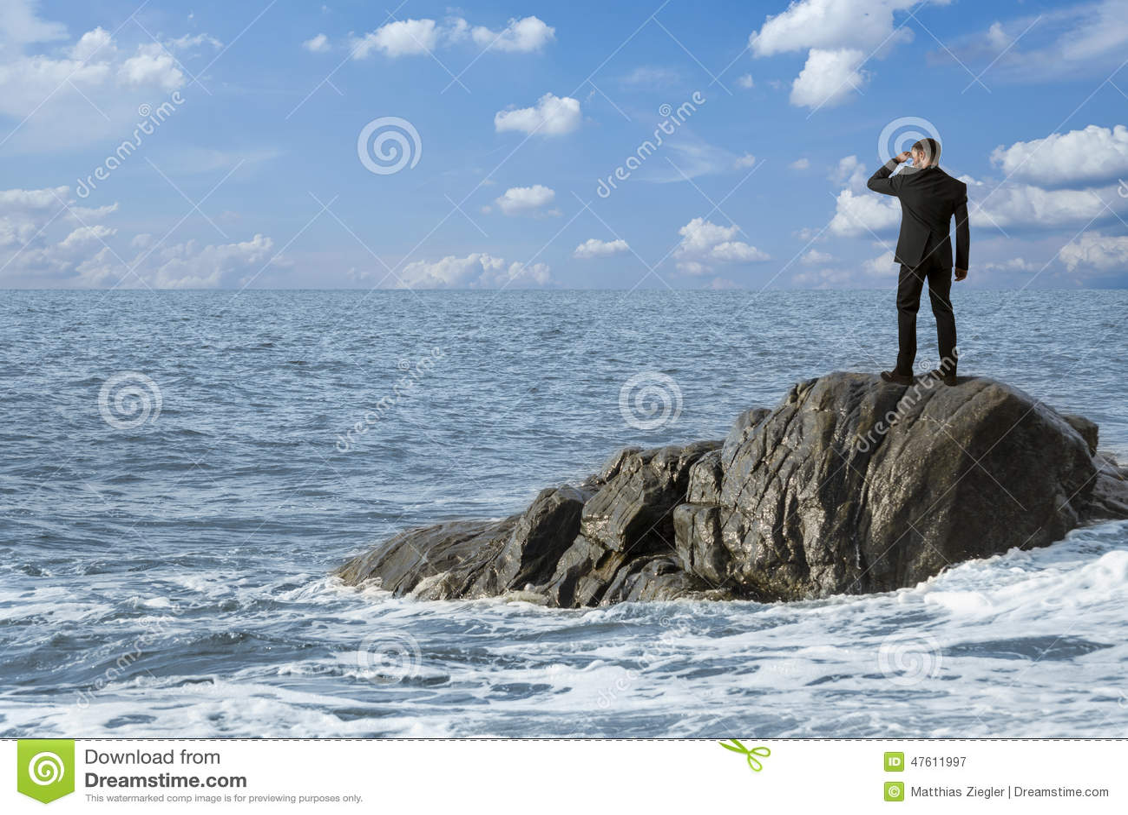 Observing man on rocks in the sea