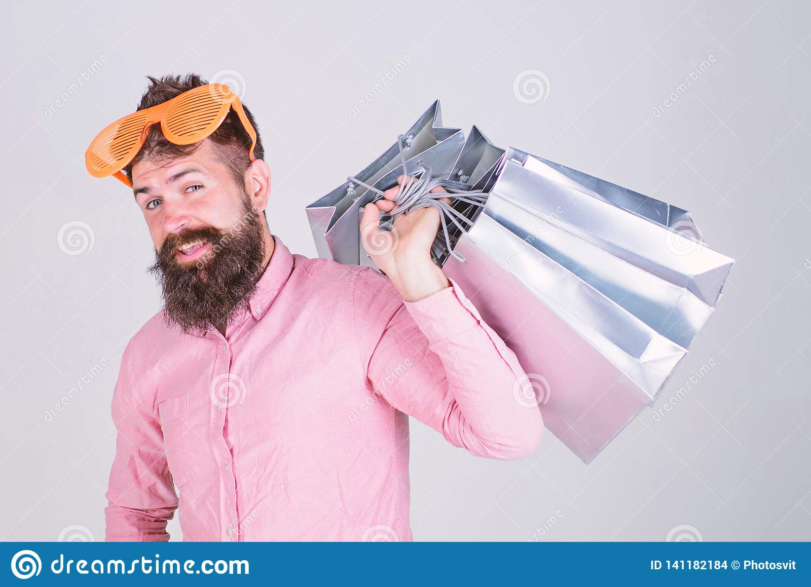 Obsessed with shopping. Addicted consumer concept. Man carefree bearded hold shopping bags. Shopping dumb wasting money
