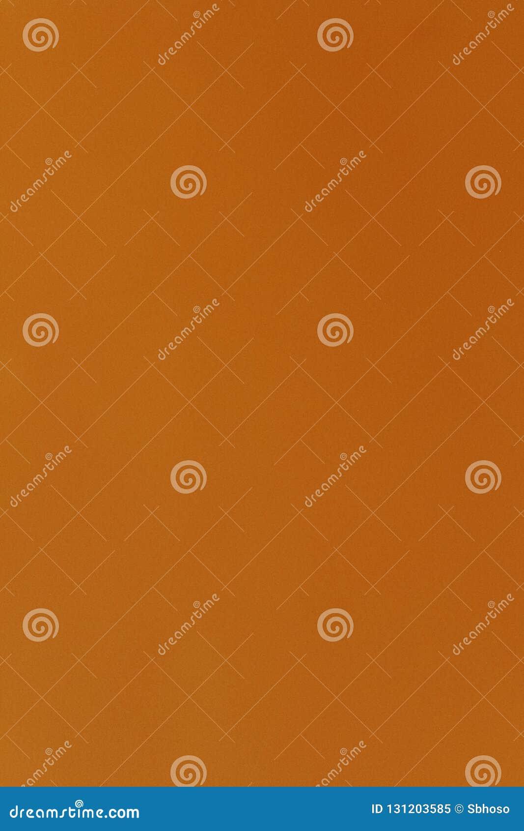 Occhio contemporaneo intenso luminoso che prende la parete arancio dello stucco dalla Sicilia