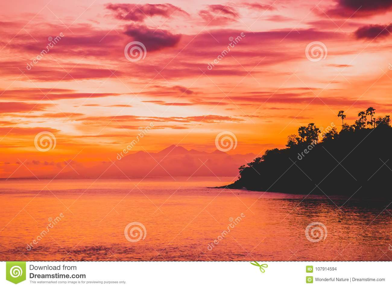 ocean at bright sunset or sunrise in ocean sea with warm sunset