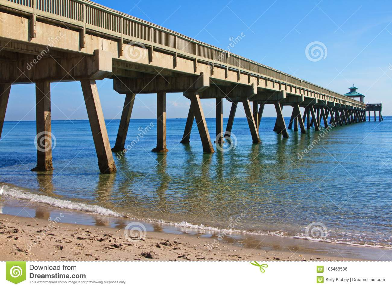 Ocean fishing pier on a clear sunny day stock photo for Dock pilings cost