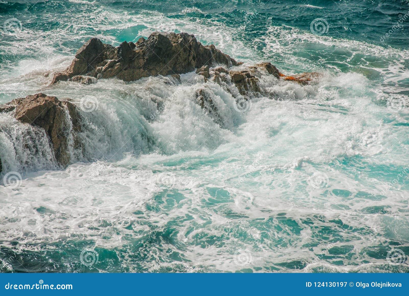 Ocean rock and wild waves