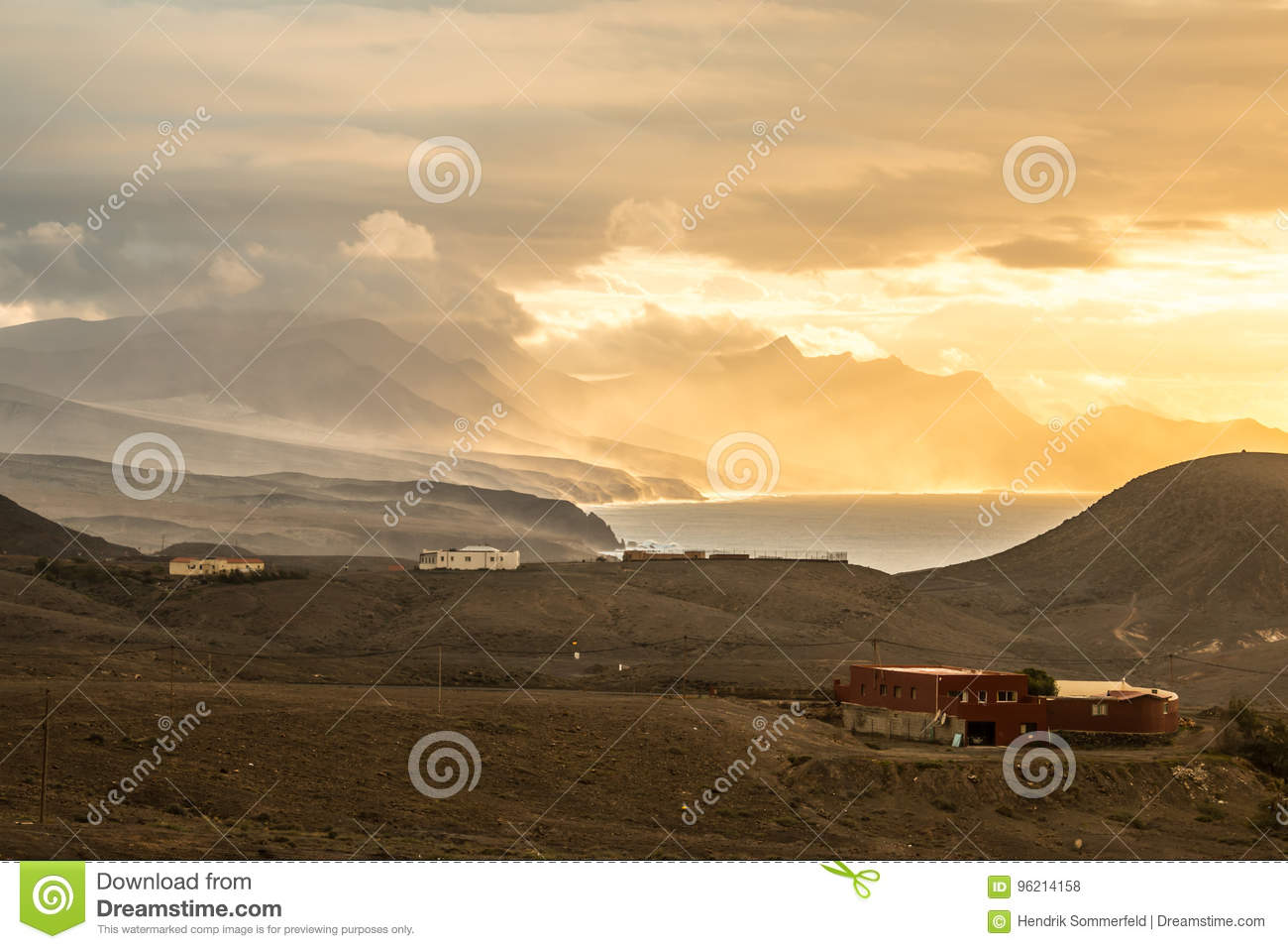 Ocean sunset scenery with mountainous coastline and epic light atmosphere