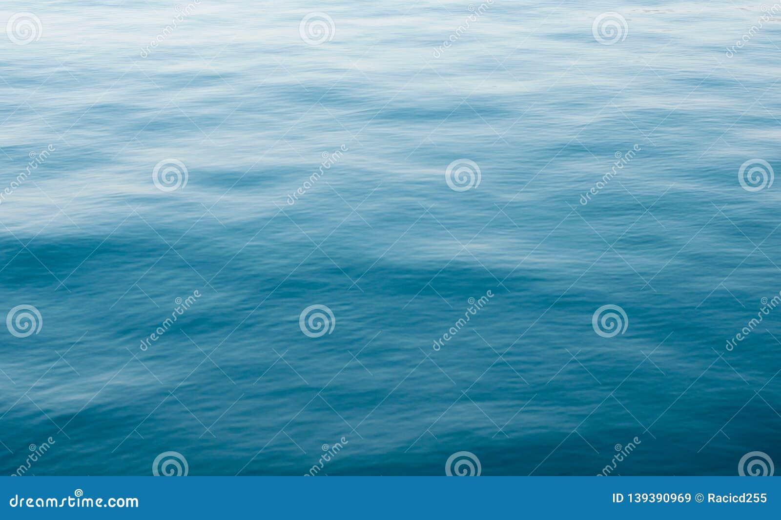 Ocean textured blue water background