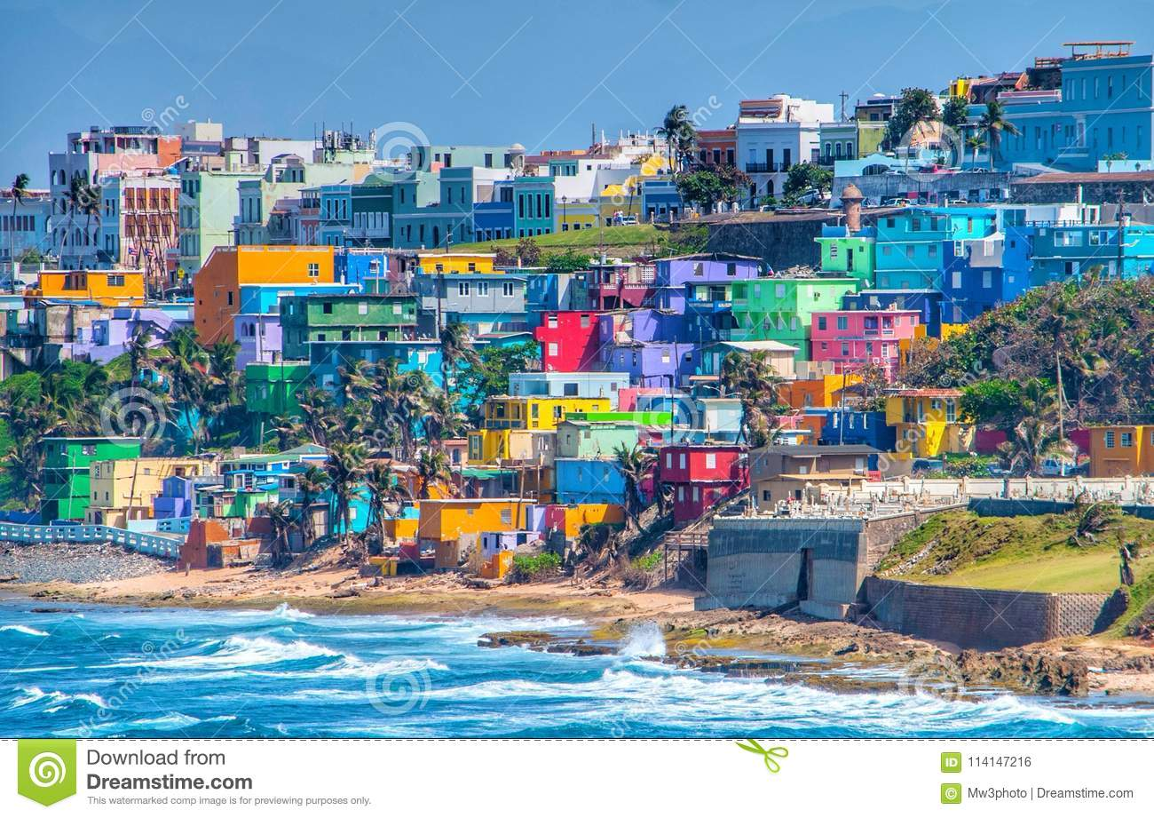 colorful house line the ocean front in san juan puerto rico stock