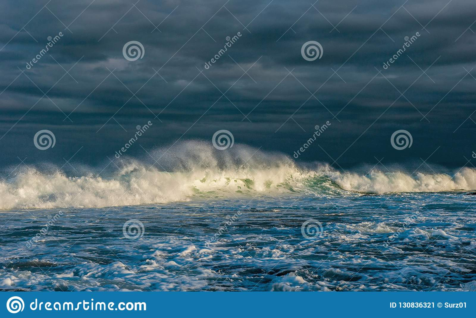 Ocean waves. Stormy weather, clouds sky background. Seascape.