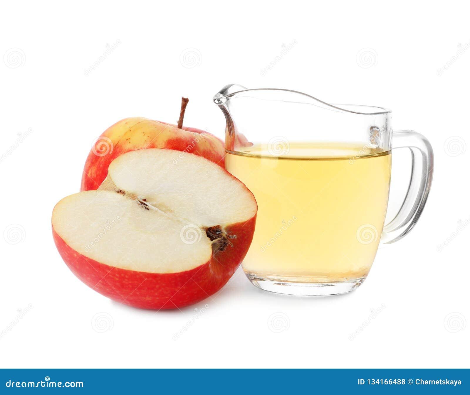 Ocet w szklanym miotaczu i świeżych jabłkach