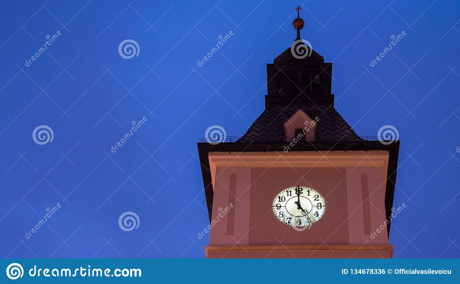5 oclock on the tower clock under the blue sky
