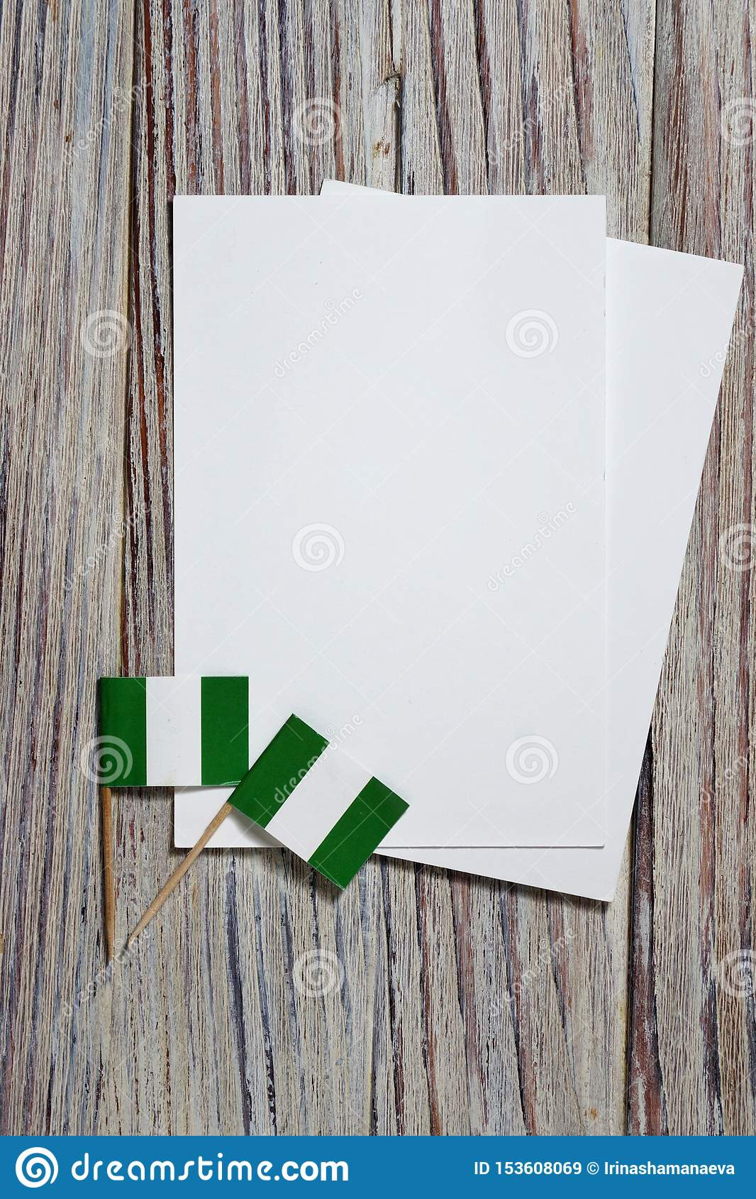 October 1. happy independence Day of Nigeria. the concept of patriotism , freedom and independence. Mini flags with a white card