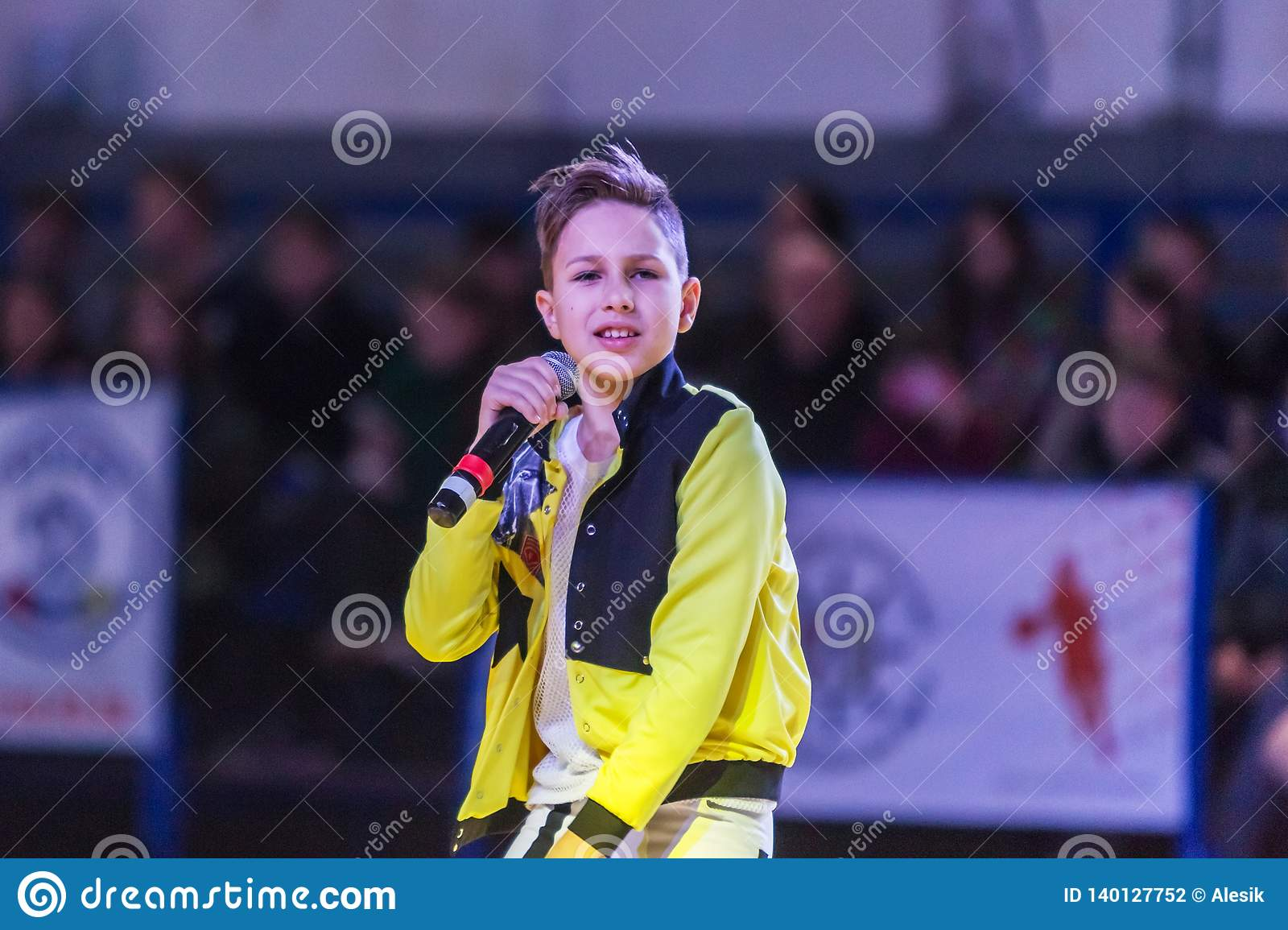 Odessa, Ukraine - February 16, 2019: Children`s music groups singing and dancing on basketball court during a commercial break.