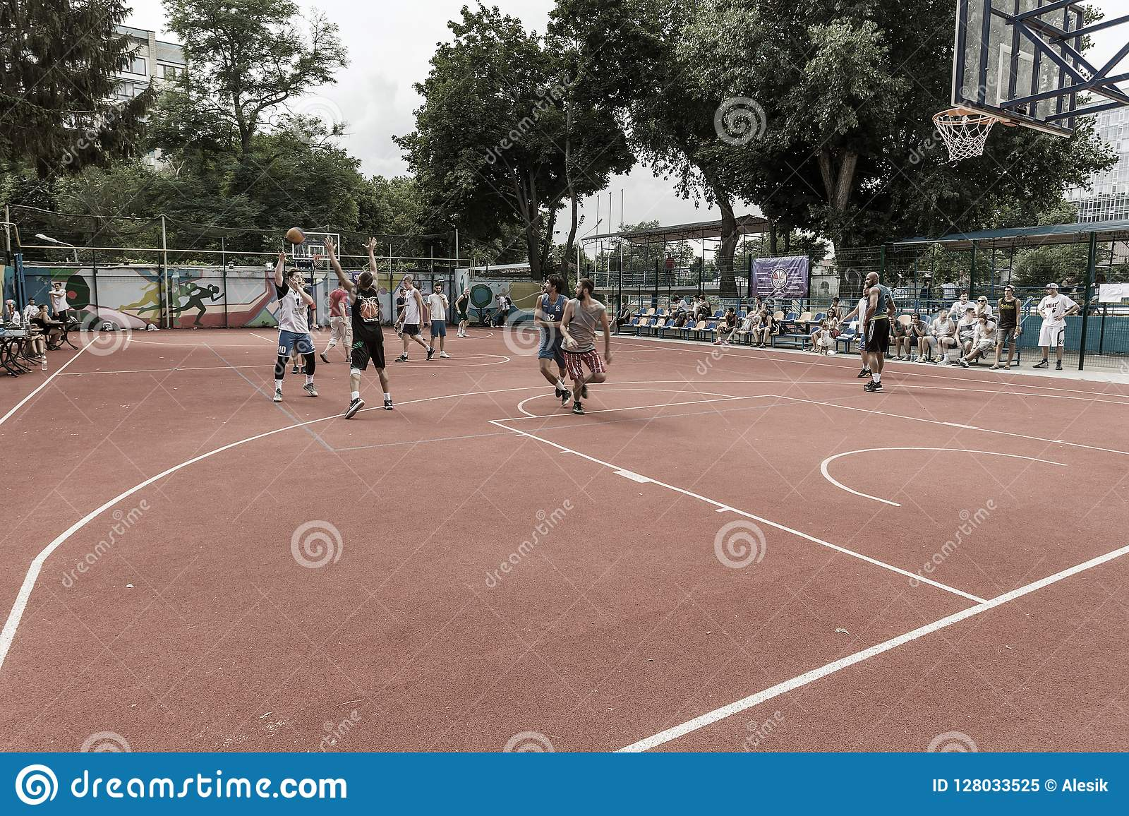 ODESSA, UKRAINE - JULY 28, 2018: Adolescents play basketball during 3x3 streetball championship. Young people play street basketba