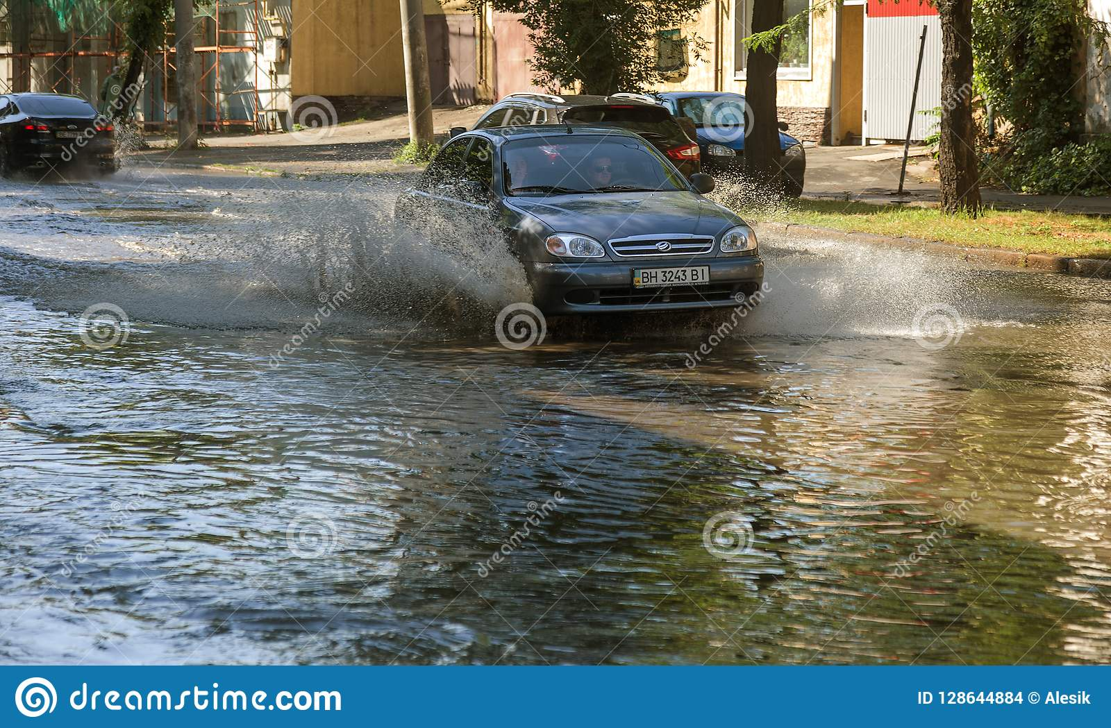 Odessa, Ukraine -3 July 2018: Driving cars on a flooded road during floods caused by rain storms. Cars float on water, flooding st