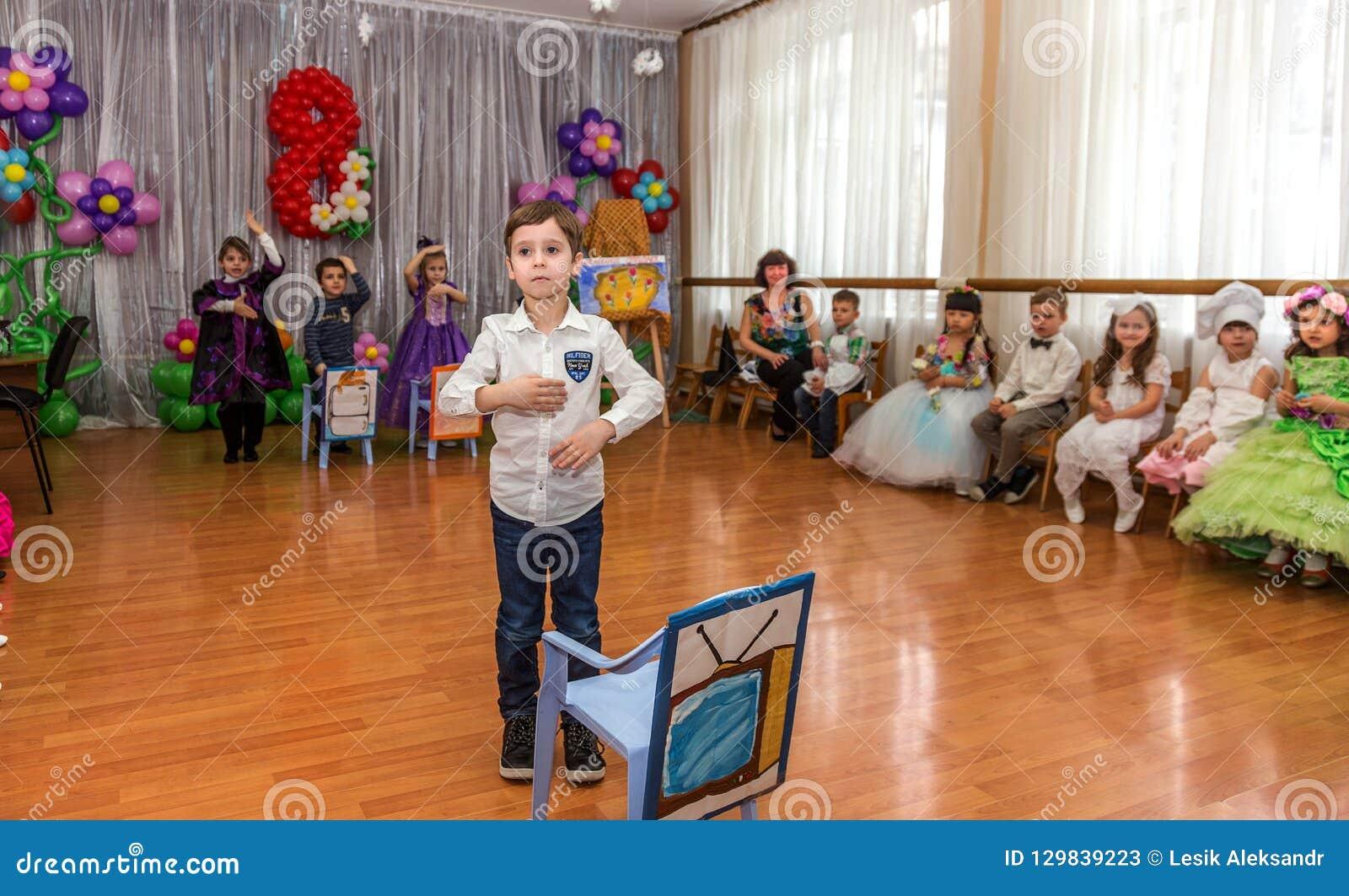 Odessa, Ukraine - March 4, 2016: children`s music groups singing