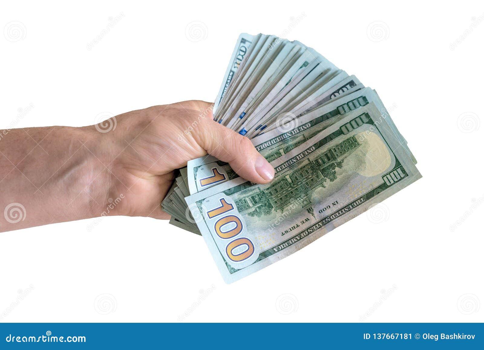 Odosobniona ręka z paczką sto dolarów