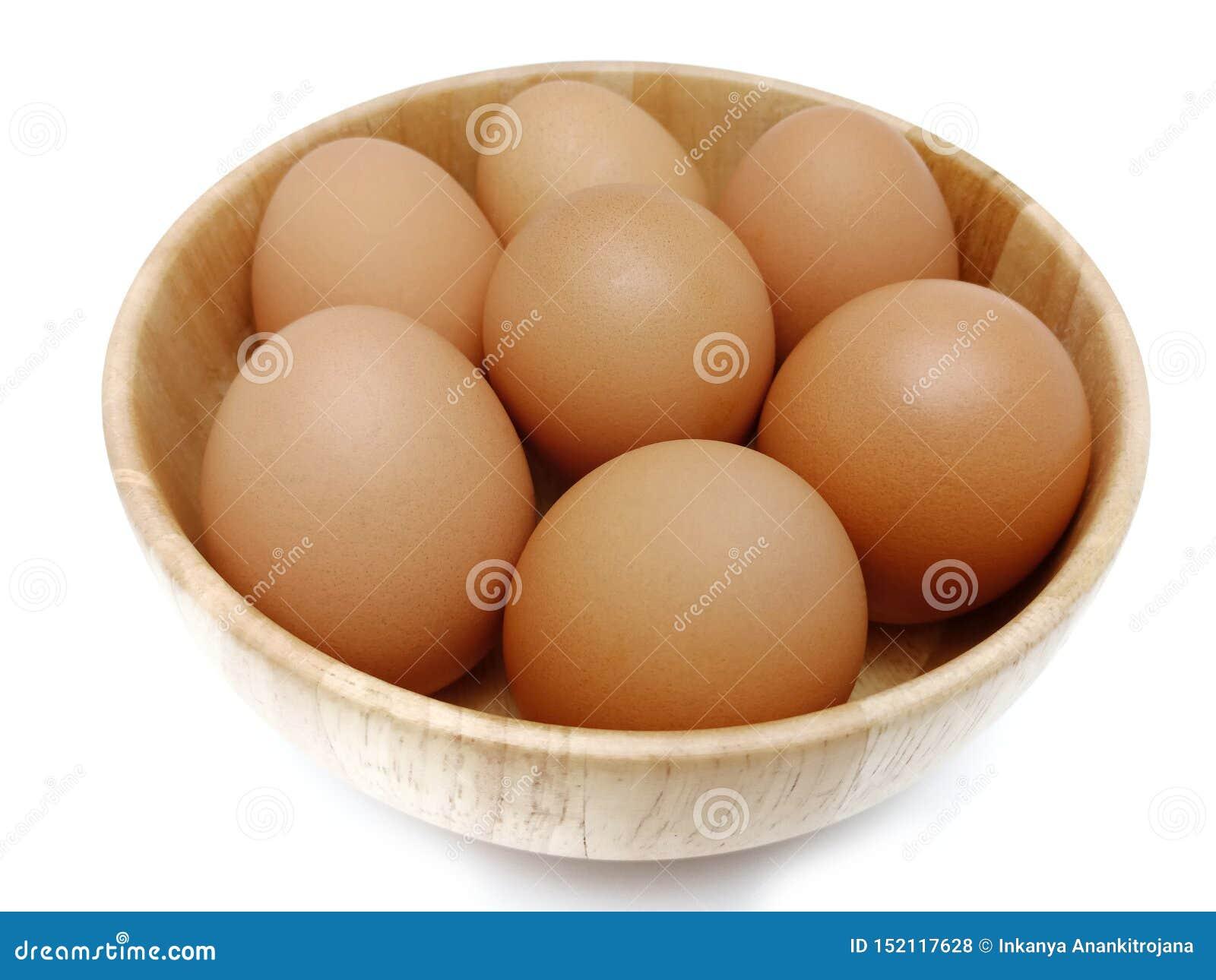 Oeufs bruns frais crus de poulet