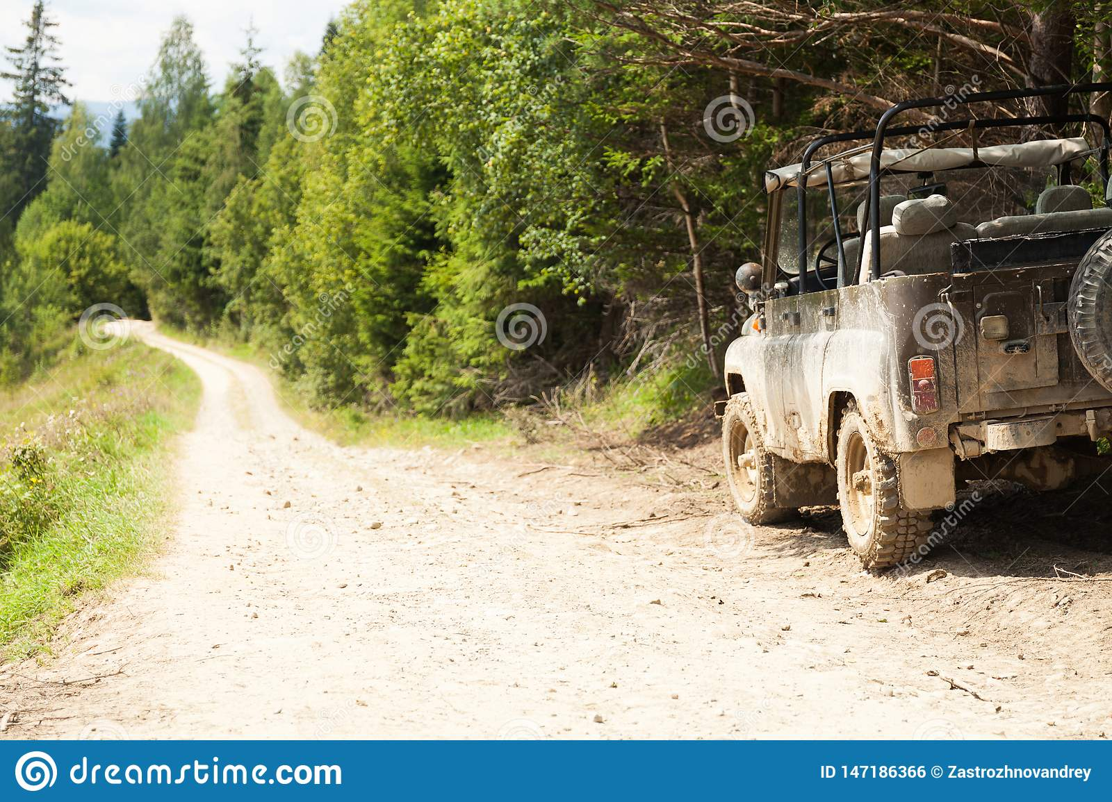 Off road 4x4 adventure, jeep on mountain dirt road. Copy space for text