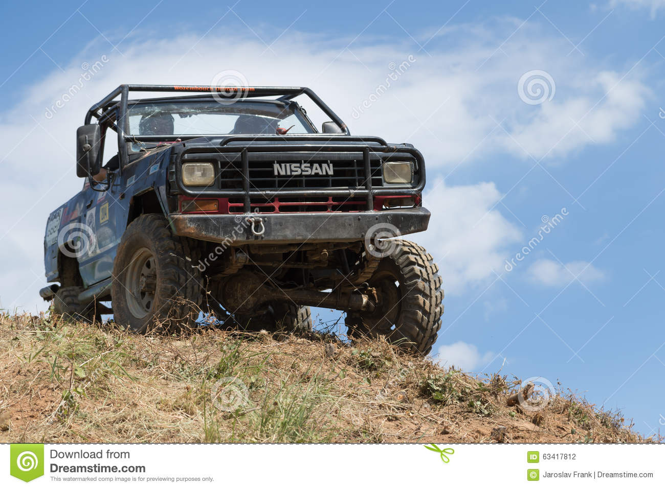 off road car and blue sky in the background editorial photography image 63417812. Black Bedroom Furniture Sets. Home Design Ideas