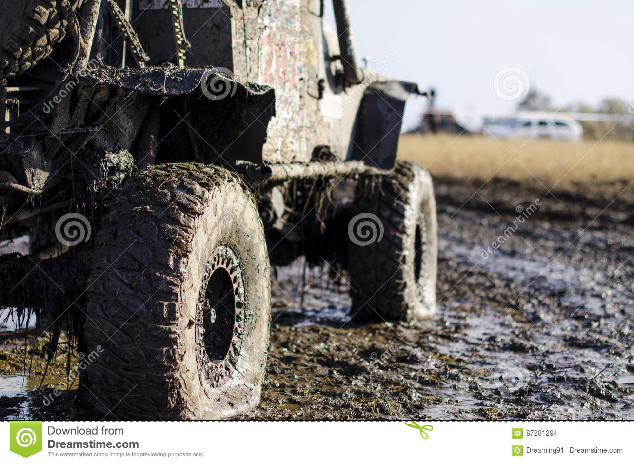 Off-road car in a puddle making mud splashes.
