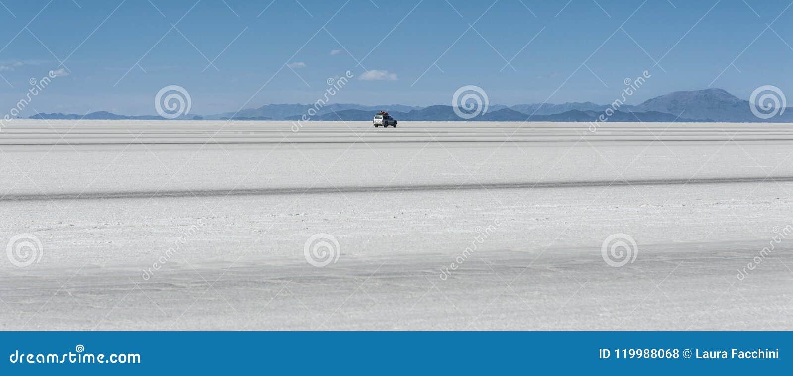 Off-road car in the Salar de Uyuni is largest salt flat in the World UNESCO World Heritage Site - Altiplano, Bolivia