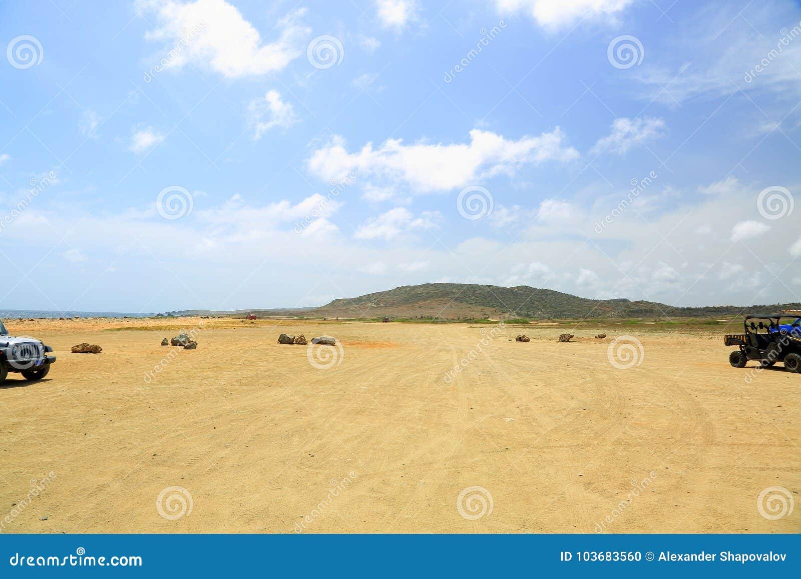 Off-road UTV Aruba tour. Amazing stone desert landscape and blue sky