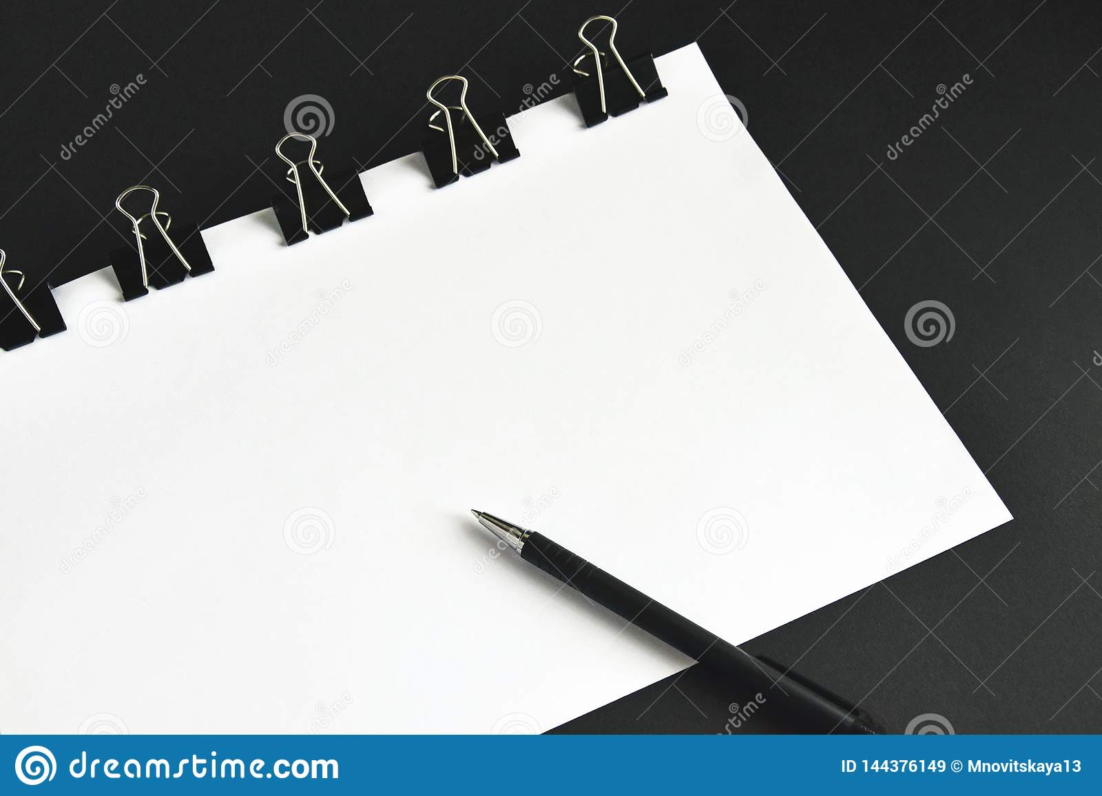 Office accessories, white sheets, pen and binder clip