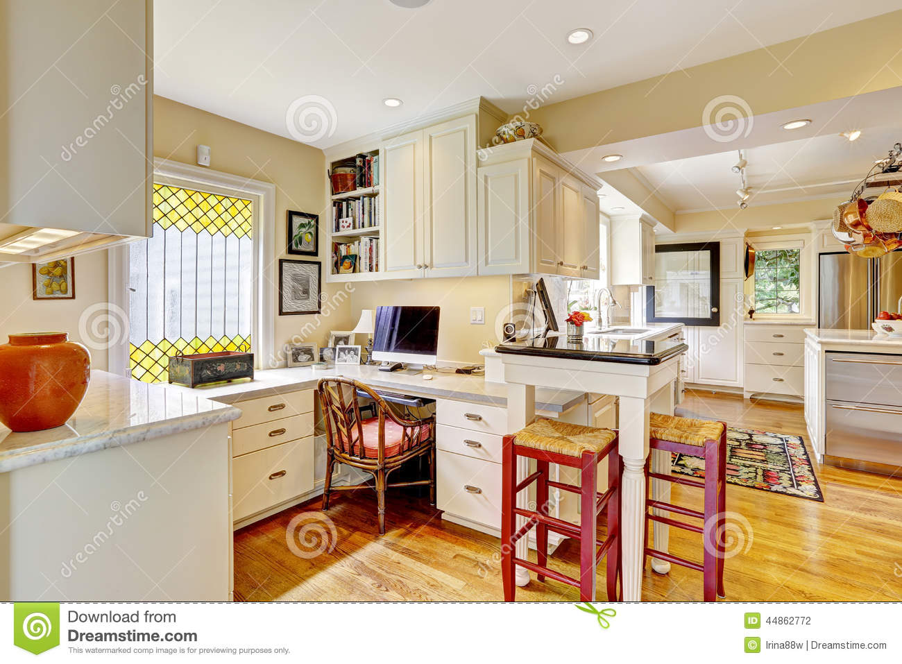 Kitchen Desk Area Office Area With White Cabinets And Desk Stock Photo Image 44862772