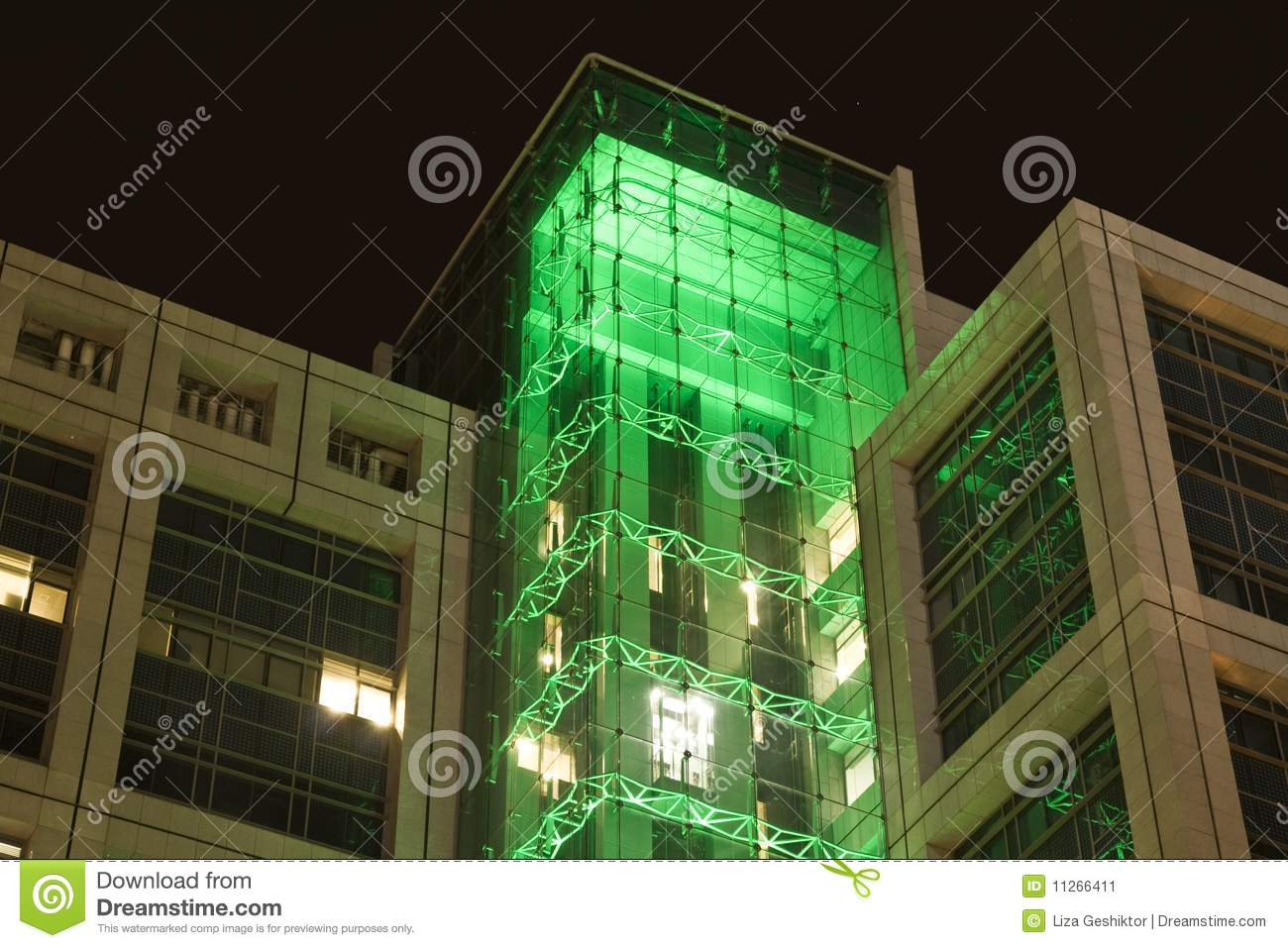 Glass Building Light : Office building at night with green lights stock image