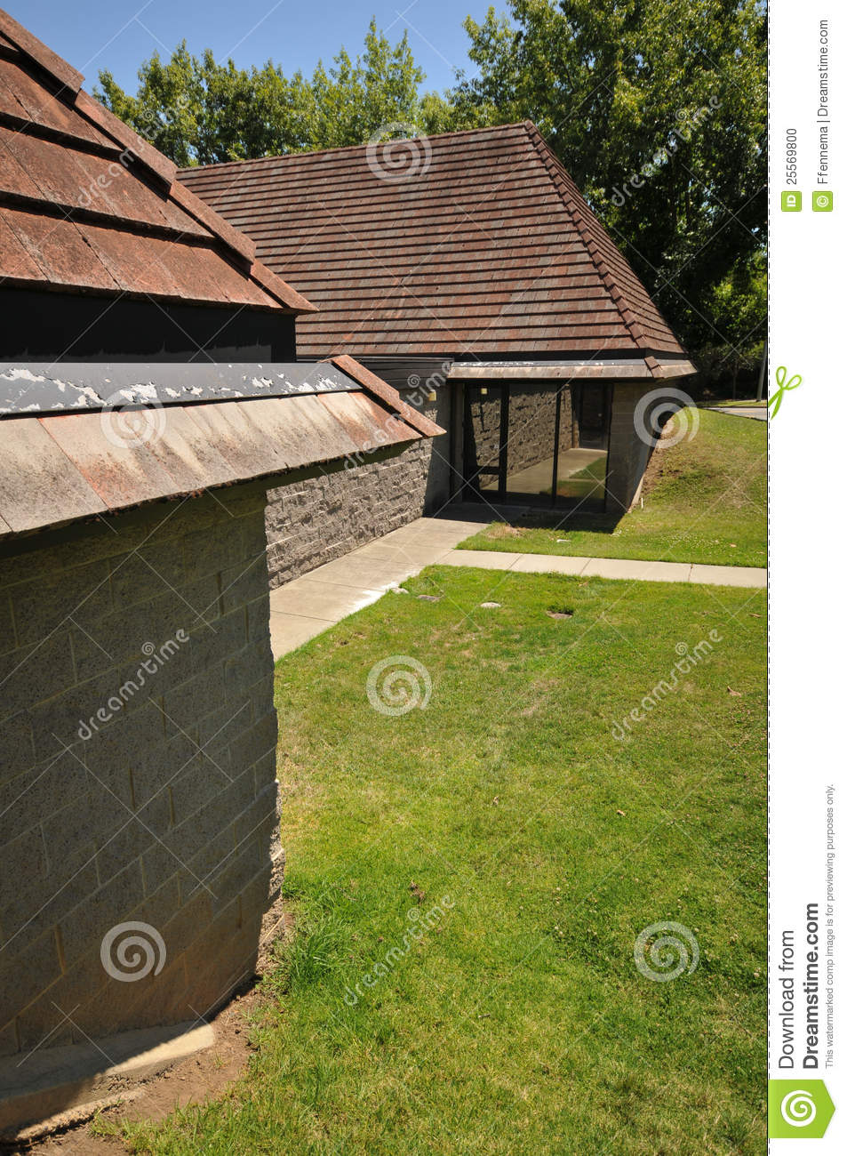 an office building partially underground grass stock photo