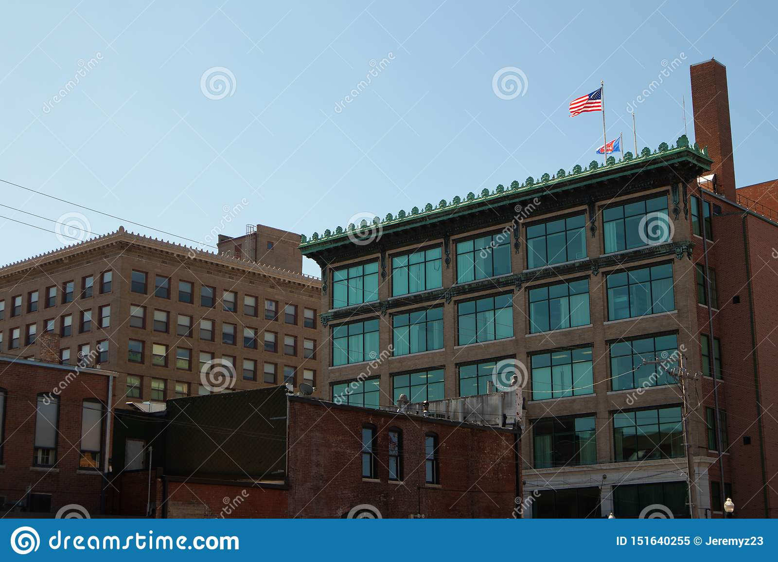 Office buildings with American Flag on roof