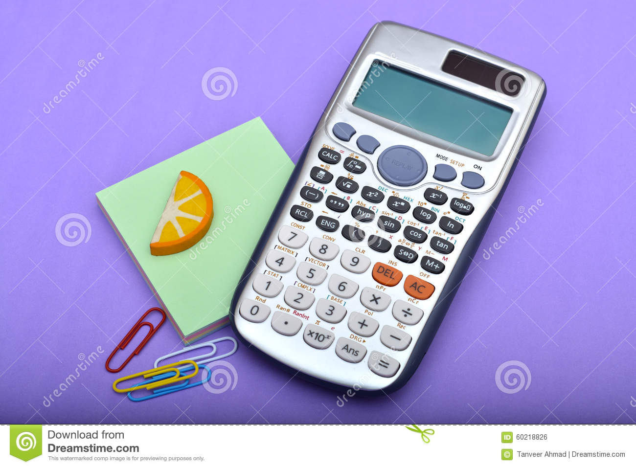 Office Calculator With Paper Pins Closeup Stock Photo