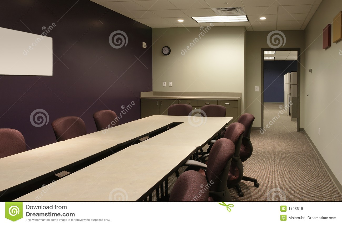 Office Conference Workspace With Purple Wall Stock Image