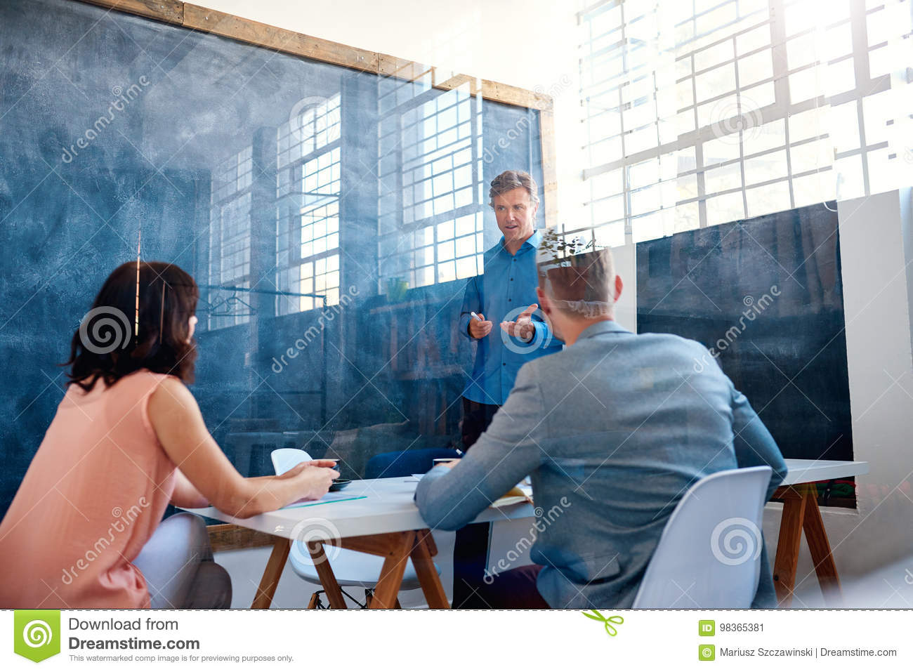Office Coworkers Brainstorming Together Inside Of A Meeting Room