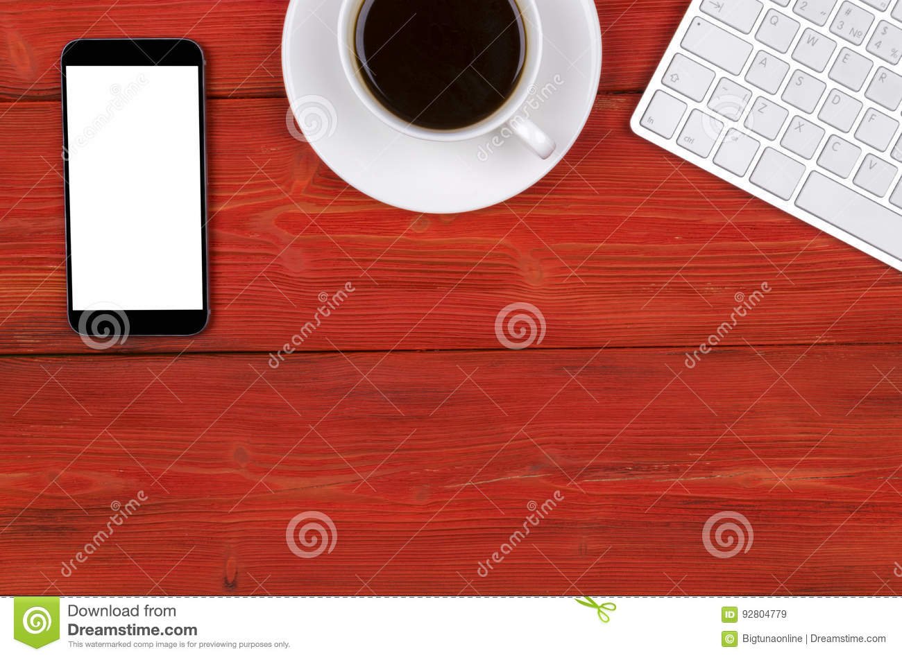 Office desk with copy space. Digital devices wireless keyboard, mouse and tablet computer with empty screen on red wooden table w