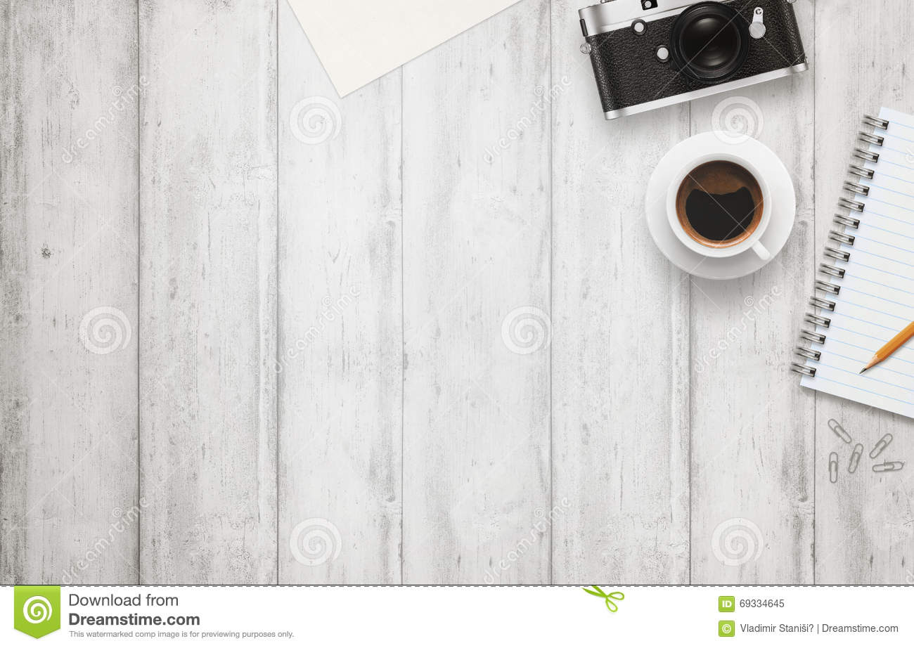 office desk with free space for text camera cup of