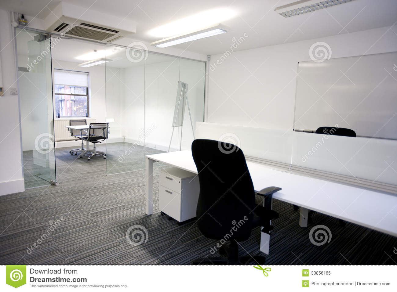 Office Desk With Meeting Room In Background Royalty Free