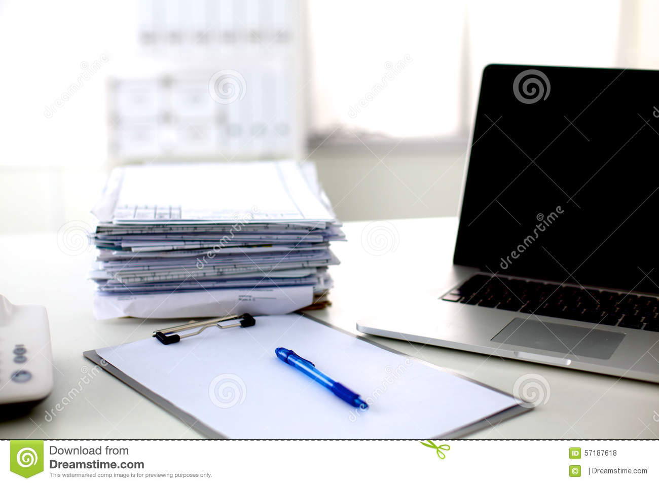 office desk a stack of computer paper reports work stock photo