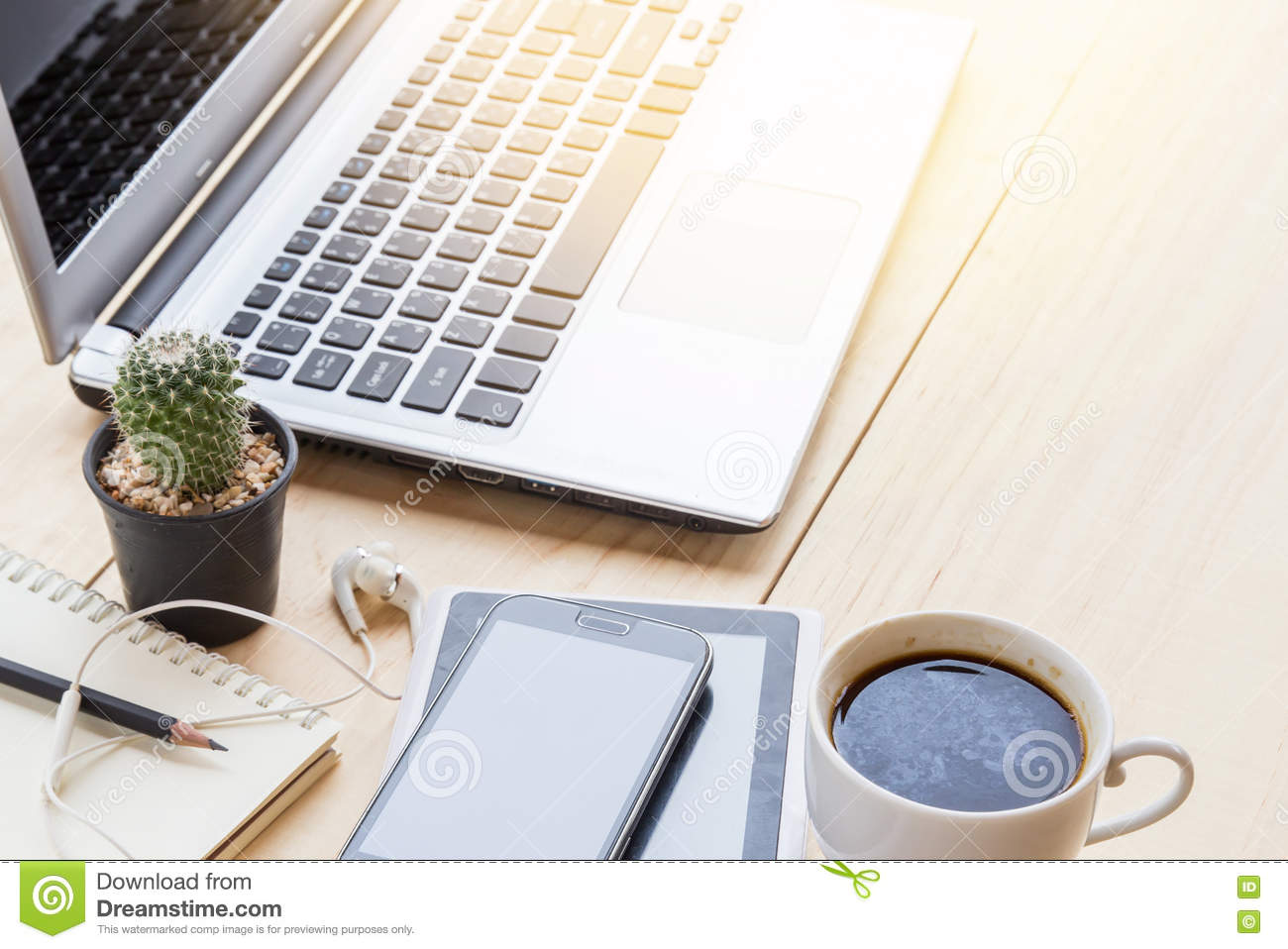 Office Desk Table With Laptop Computer Coffee Cup And Flower Royalty Free Stock Image