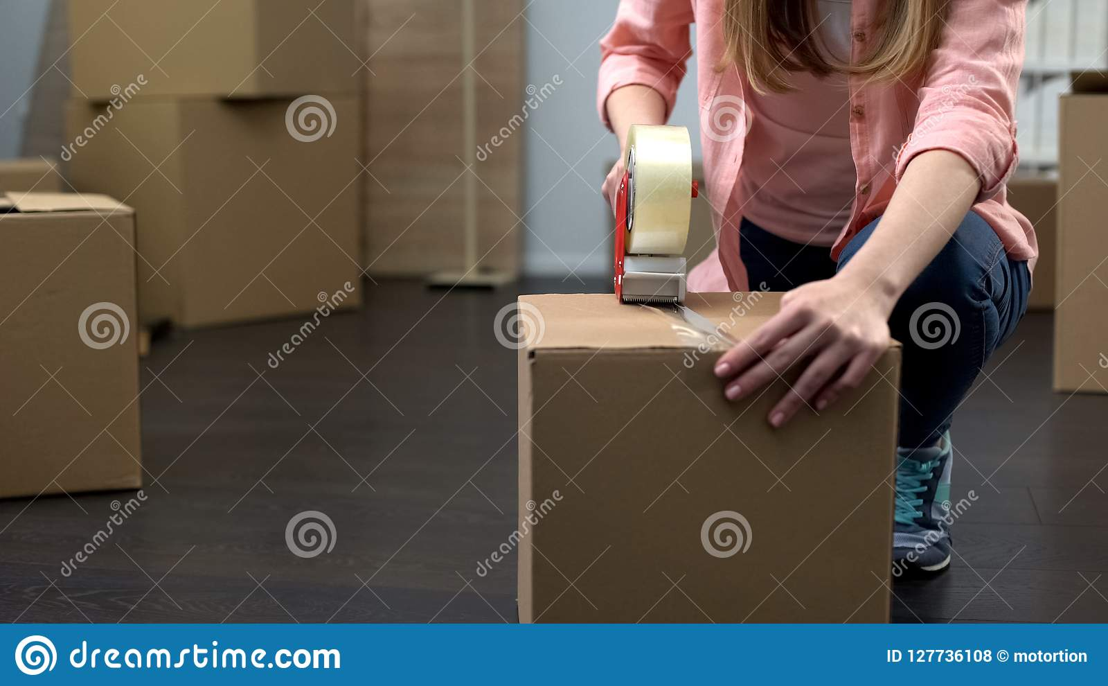 Office employee packing equipment and stuff for removal, business expansion