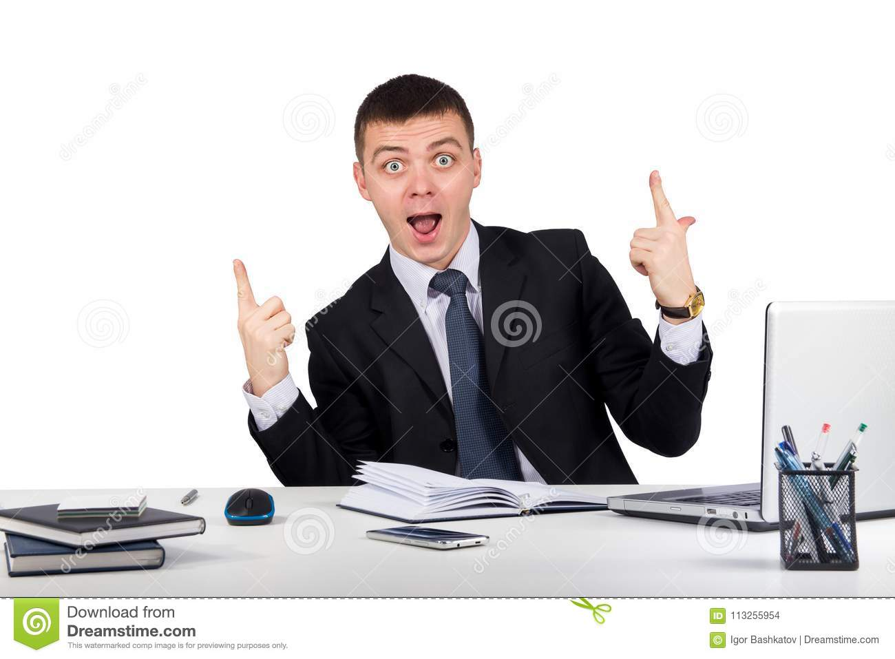 Portrait of happy businessman showing thumbs up