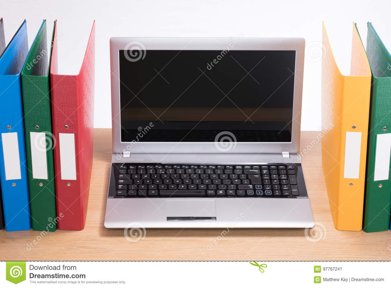 - Office Folders And Open Laptop Computer On Desk Stock Image