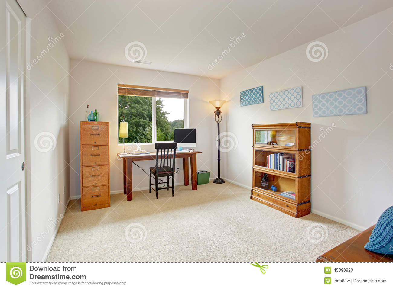 Office Interior With Simple Desk And Bookshelf Stock Photo
