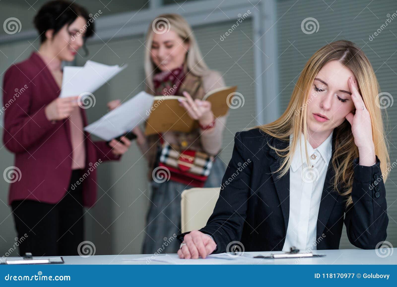 Office buzz woman headache noisy workspace