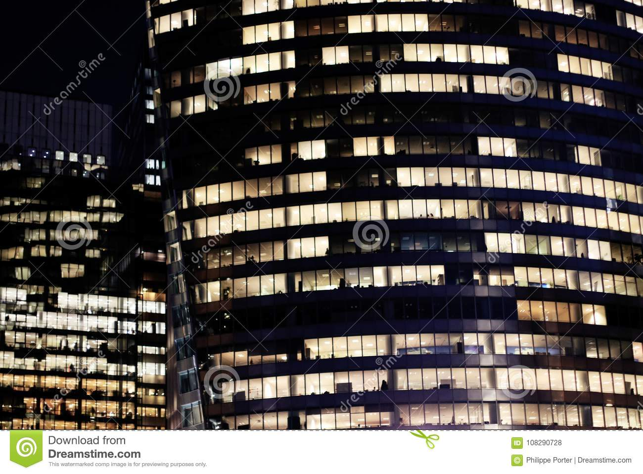 Glass office skyscrapers at night illuminated windows in the Paris business district